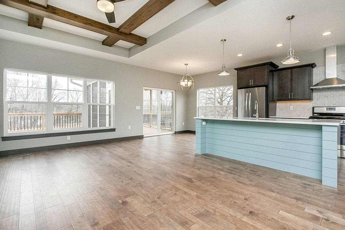 The roomy spare space with hardwood flooring is dedicated to the living room and dining area.