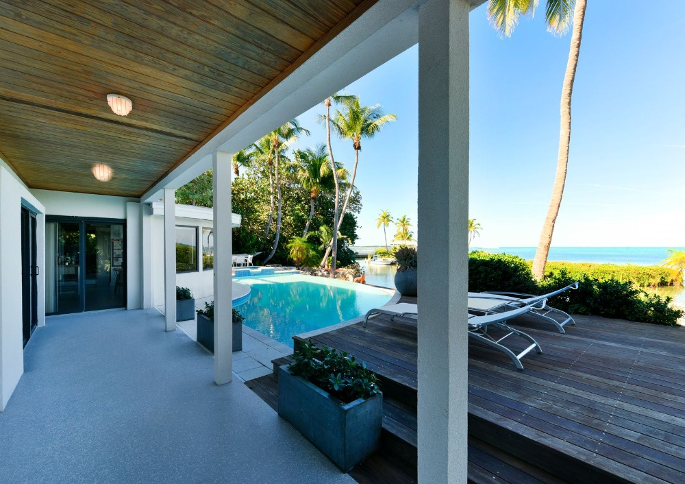 There'a a small deck area near the swimming pool too. Image courtesy of Toptenrealestatedeals.com.