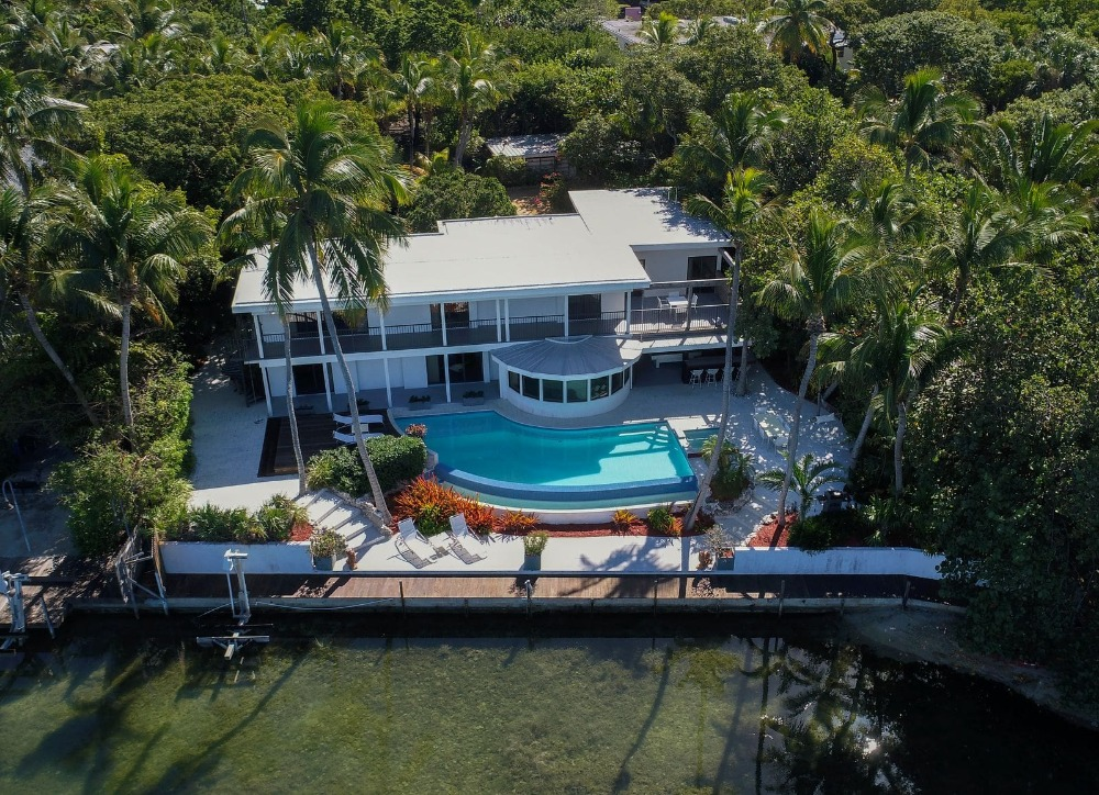 Aerial view of the house showcasing its modern exterior and outdoor amenities. Image courtesy of Toptenrealestatedeals.com.
