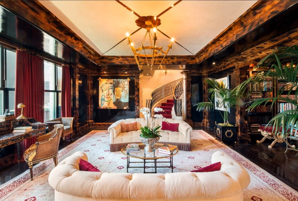 Living room with an elegant sofa set along with stunning walls and a tray ceiling. Image courtesy of Toptenrealestatedeals.com.