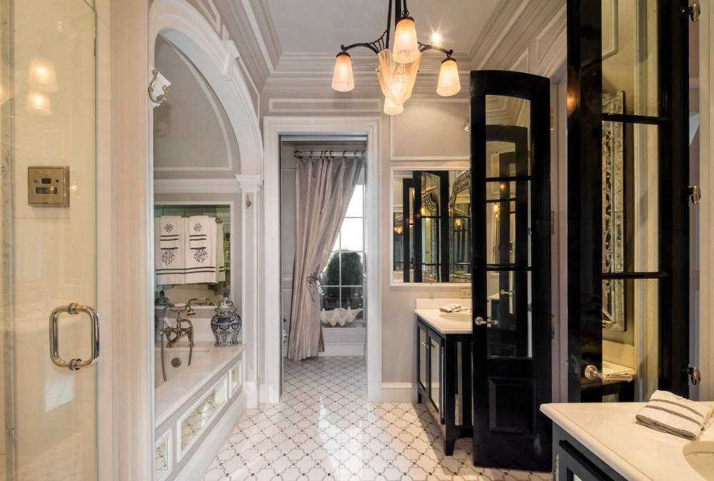 Bathroom with two sink counters, a drop-in soaking tub and a walk-in shower room. Image courtesy of Toptenrealestatedeals.com.