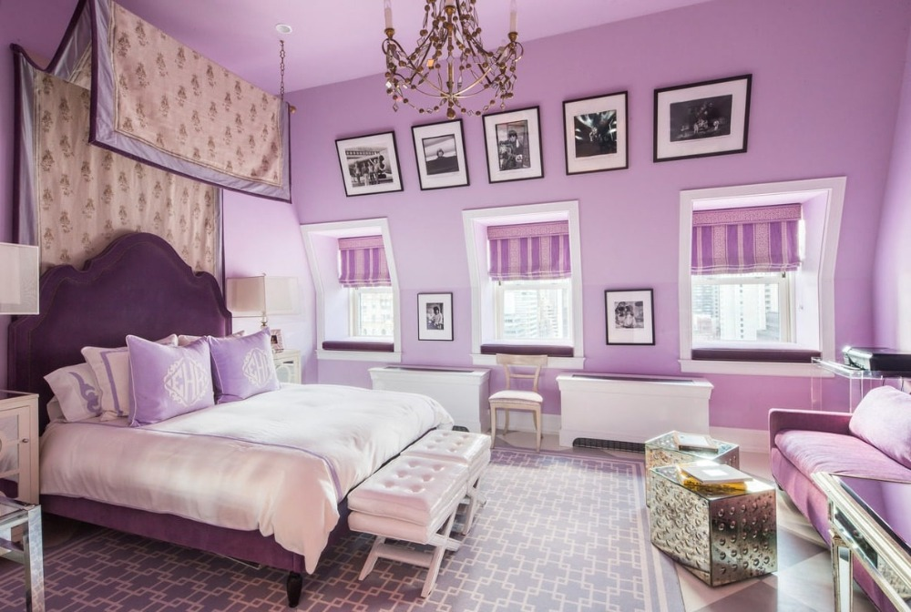 Bedroom featuring purple walls and a purple rug covering the checker tiles flooring. Image courtesy of Toptenrealestatedeals.com.