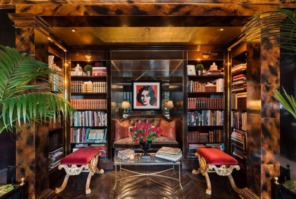 Library area with multiple built-in shelves along with charming seats and gorgeous lighting. Image courtesy of Toptenrealestatedeals.com.