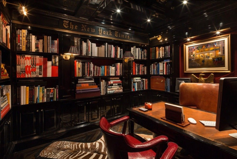Home office surrounded by multiple built-in shelves filled with books. Image courtesy of Toptenrealestatedeals.com.