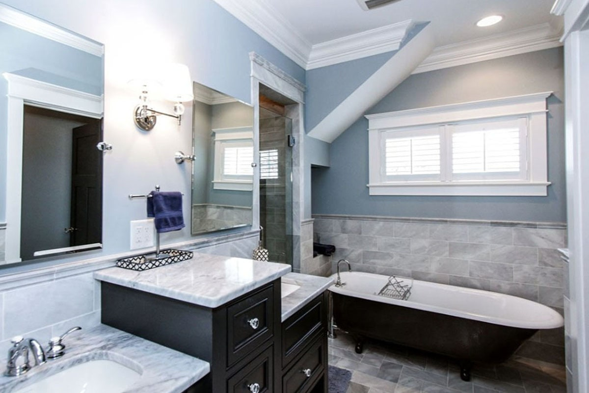 Primary bathroom with a walk-in shower, a freestanding tub, and dual sink vanity paired with frameless mirrors.