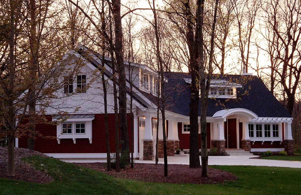 Tapered columns adorned the facade along with an enticing front porch that's topped with a barrel roof.