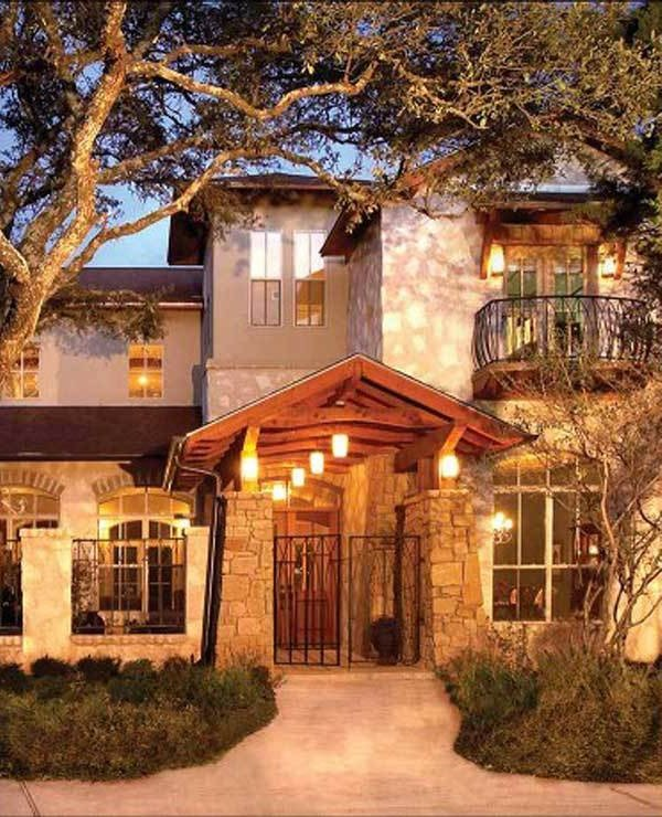 Home entry with a beamed cathedral ceiling supported by large stone columns.