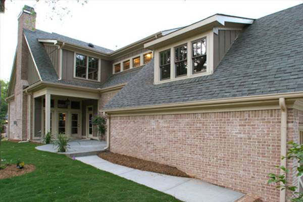 This side of the house showcases an open patio and a screened porch.