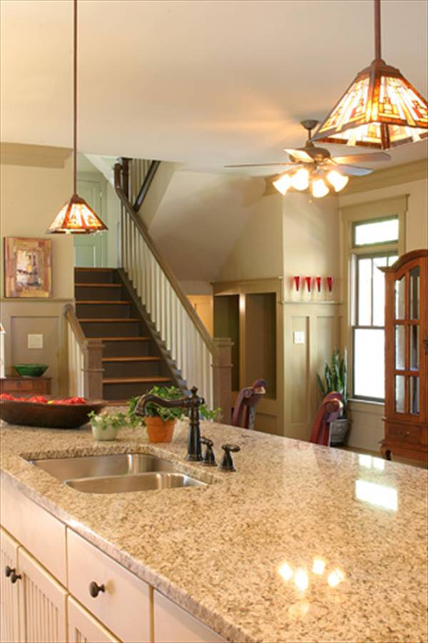 The staircase leading to the sleeping areas sits adjacent to the kitchen.