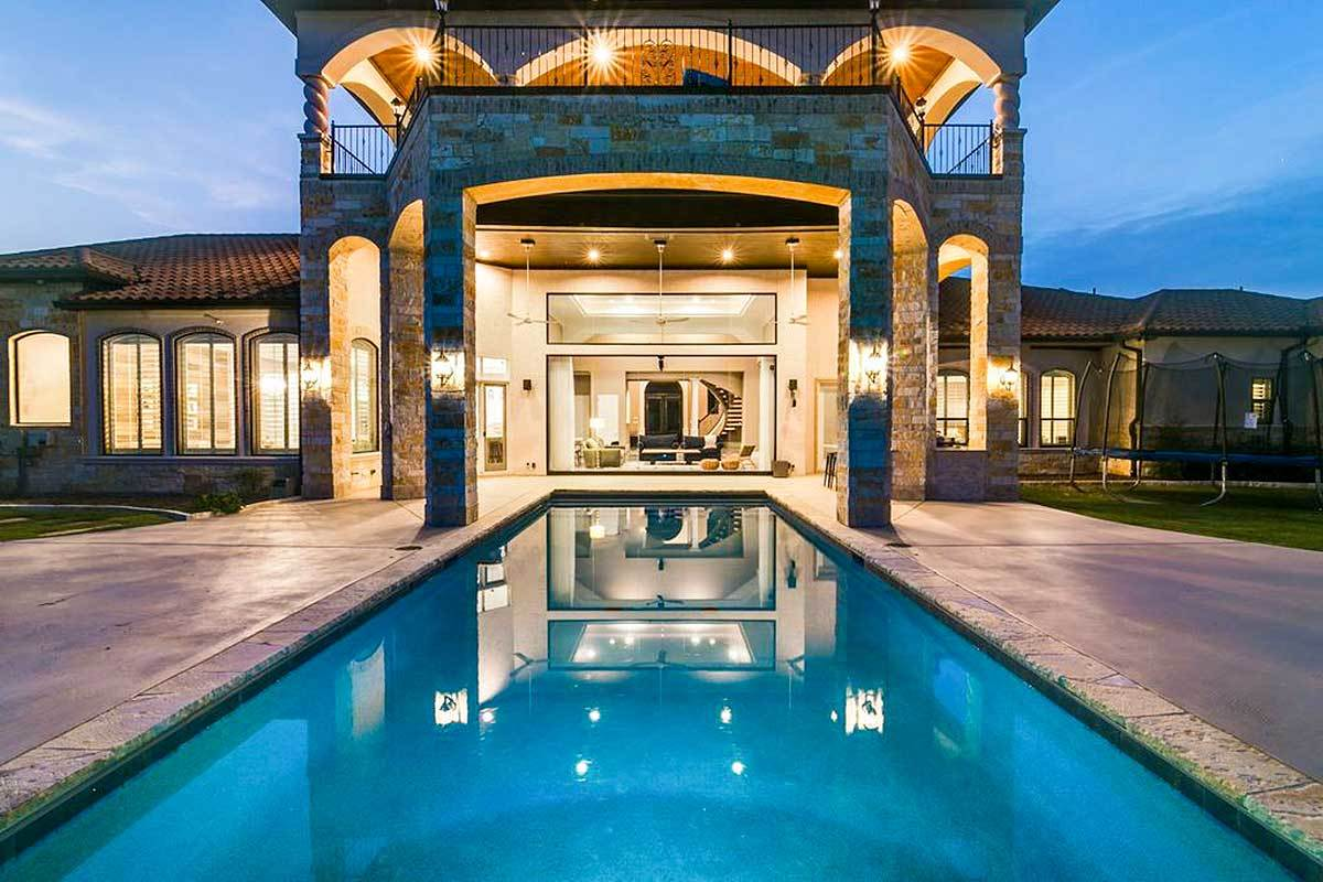 Night view of the back porch flaunting the stunning pool that stands out even at night.