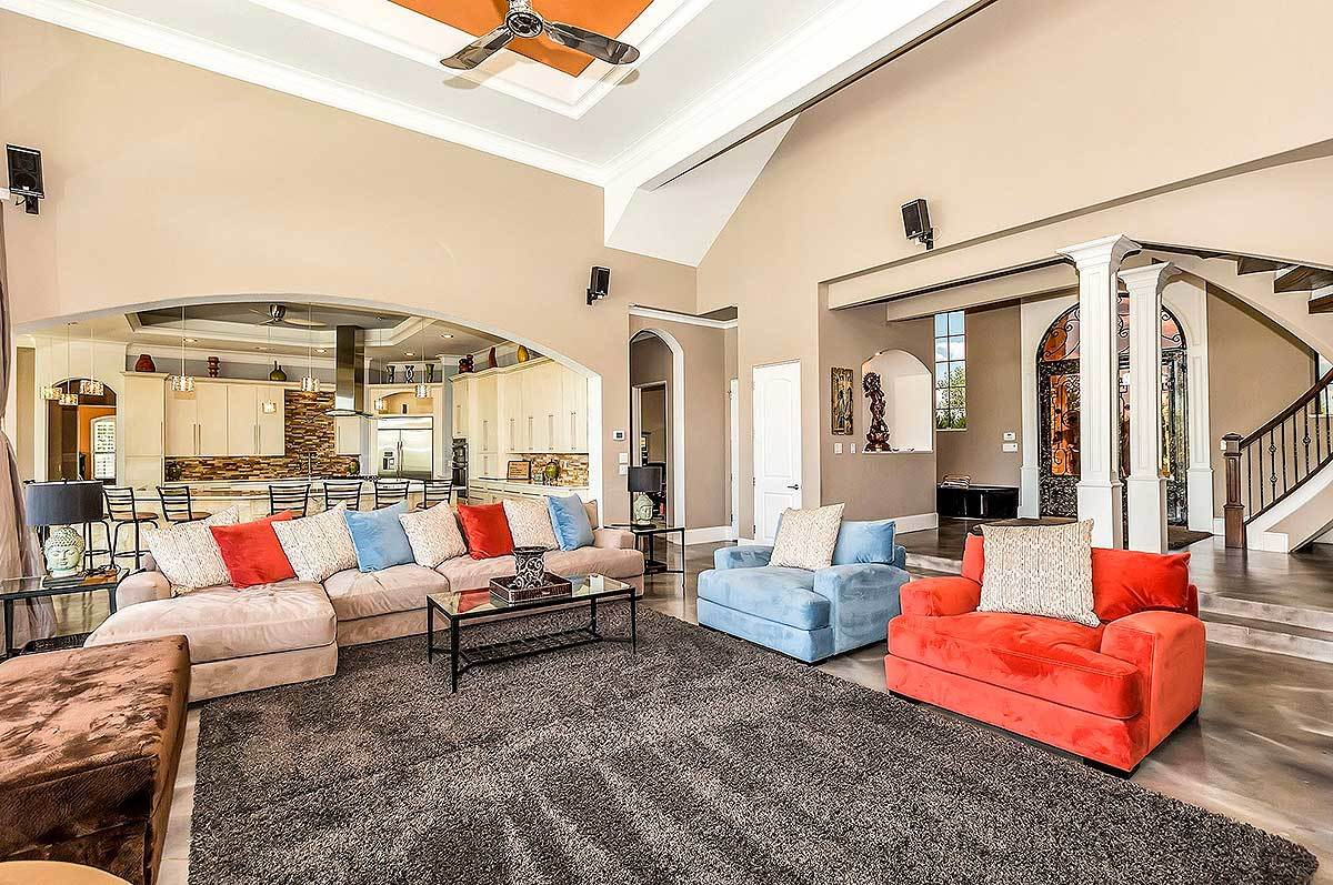 Living room with a metal coffee table and multicolored seats accented with its matching throw pillows.