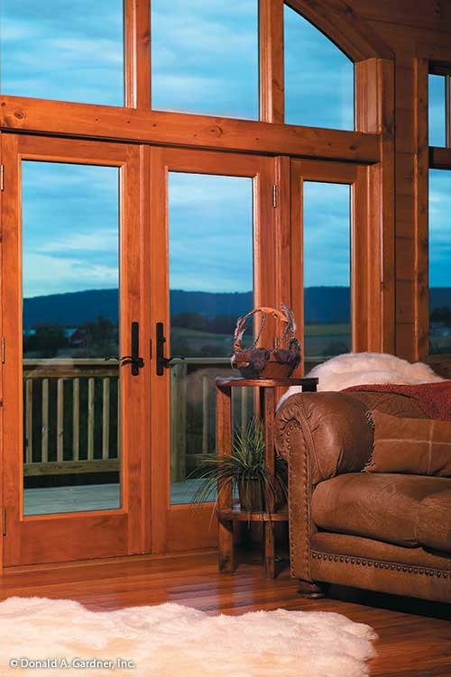 Massive windows along with a french door that leads out to the balcony provide a panoramic view of the serene surrounding.