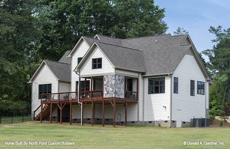 Side exterior view showcasing a screened porch accentuated with gorgeous stones.