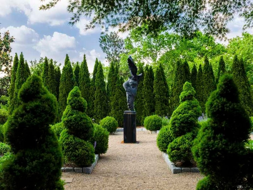 The courtyard boasts magnificent greens and a stunning statue landscape decor. Images courtesy of Toptenrealestatedeals.com.