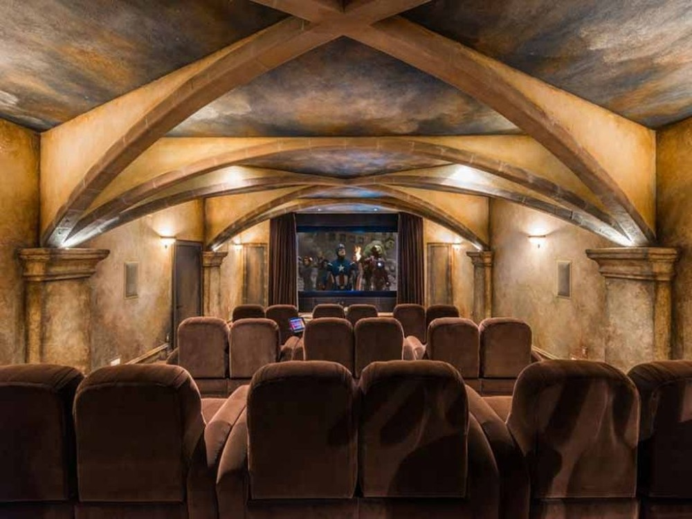 Home theater with a stunning custom ceiling and comfy sectional seats. Images courtesy of Toptenrealestatedeals.com.
