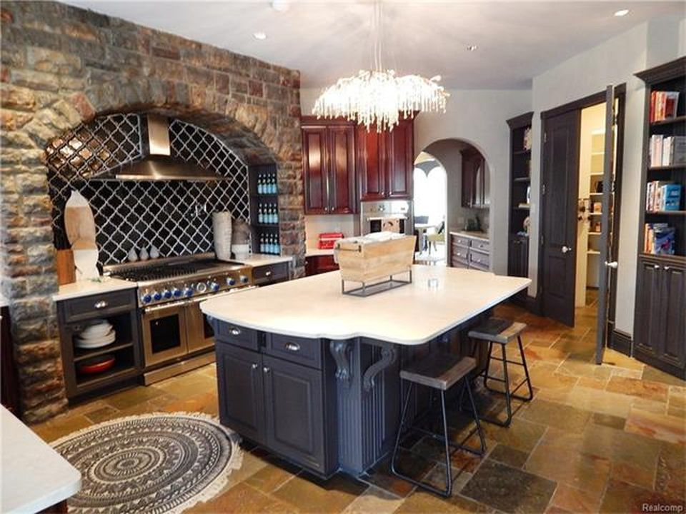 The kitchen's center island is also lighted by a magnificent ceiling light. Images courtesy of Toptenrealestatedeals.com.