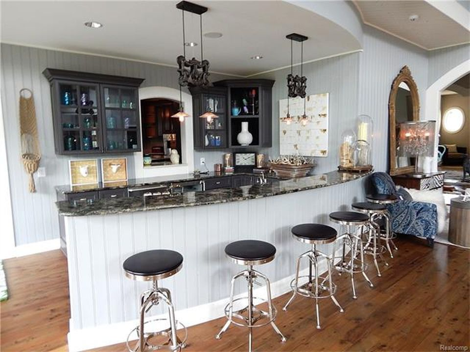 The house also boasts a large bar with a stylish counter and modern bar stools. Images courtesy of Toptenrealestatedeals.com.