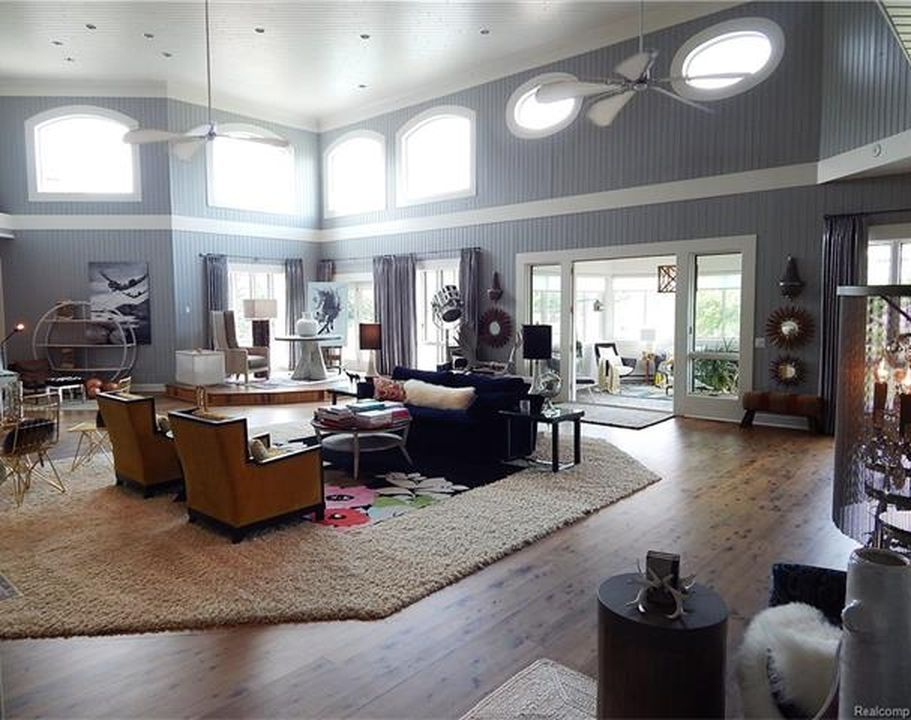 This living space is also situated under the home's two-story ceiling. Images courtesy of Toptenrealestatedeals.com.