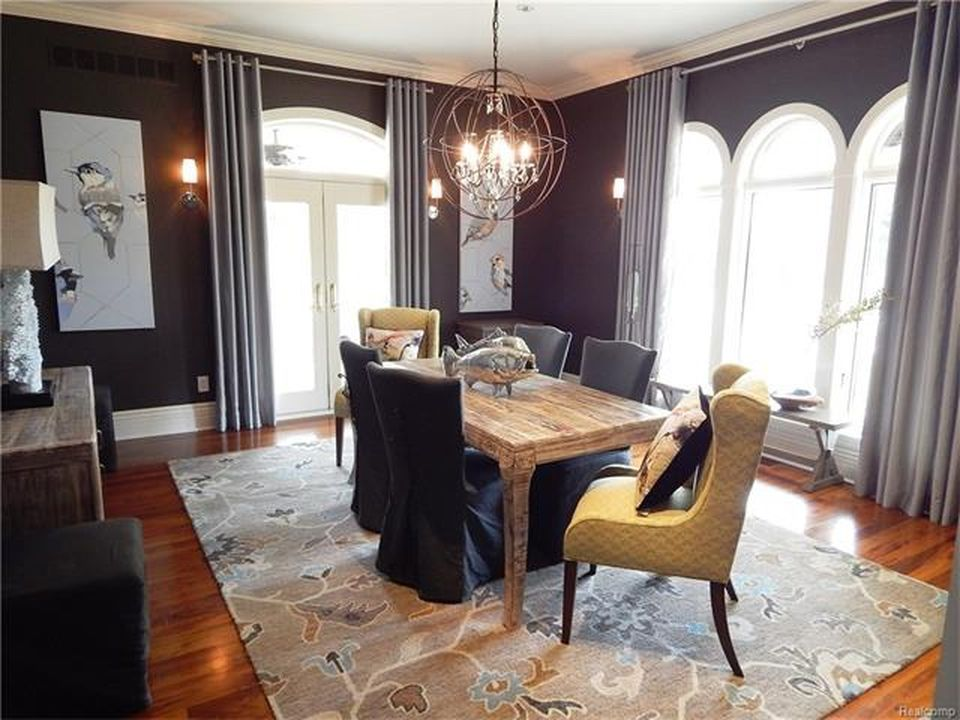 Formal dining featuring a rustic dining table paired with charming seats on top of an area rug. Images courtesy of Toptenrealestatedeals.com.