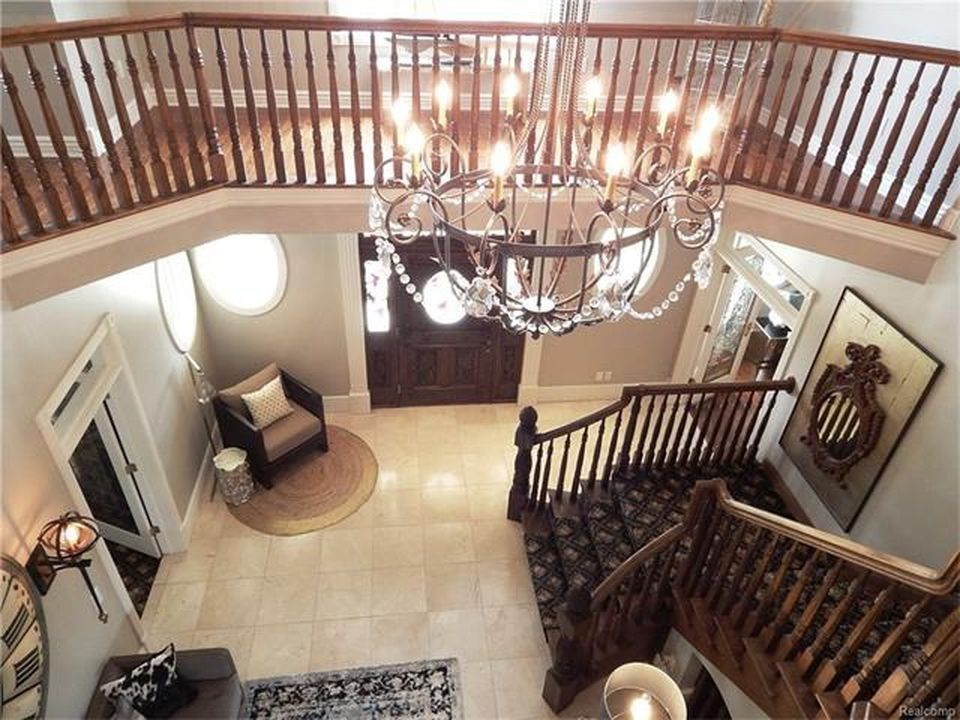 Another view of the home's entry lighted by a glamorous chandelier. Images courtesy of Toptenrealestatedeals.com.