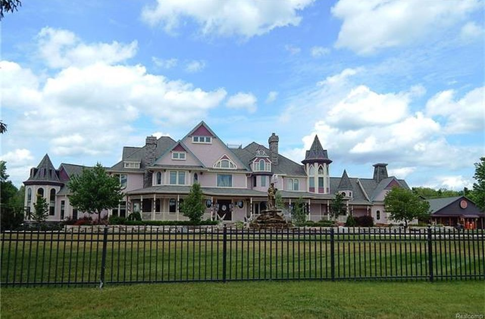 A look at the mansion outside of the fence, showcasing its exterior. Images courtesy of Toptenrealestatedeals.com.