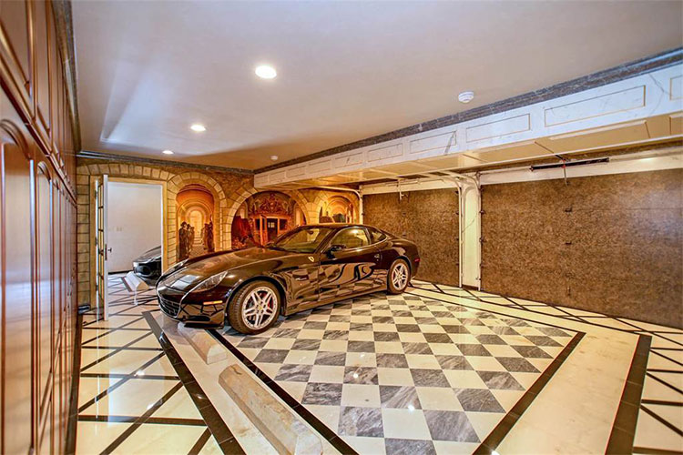 The garage is also festooned with patterns on its marble floor that has gray and beige checkered patterns that contrast the brown garage doors. Image courtesy of Toptenrealestatedeals.com.