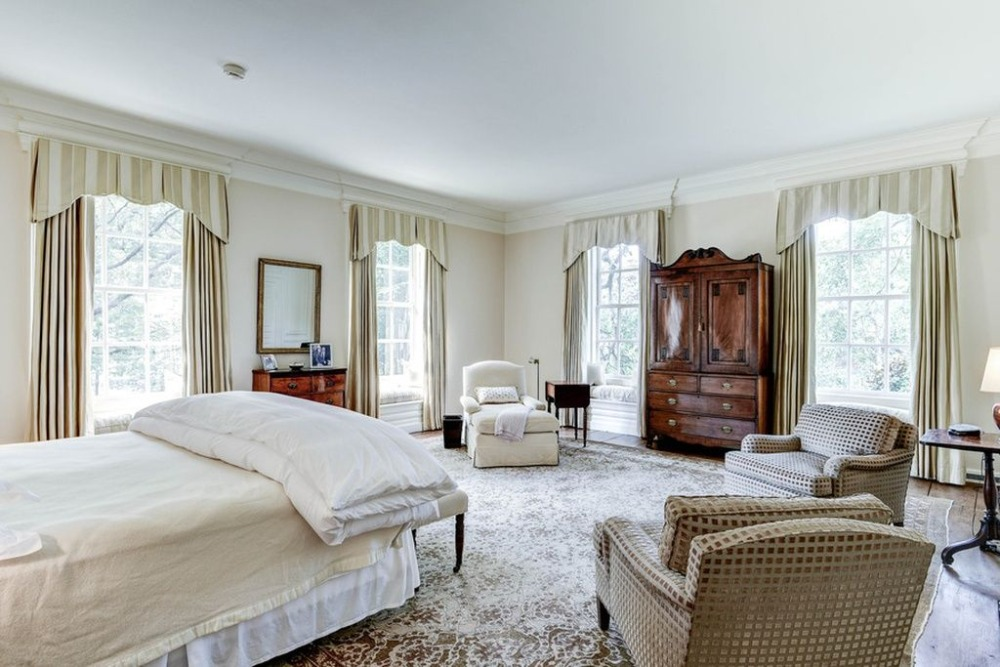 This bedroom offers a nice bed and sitting chairs, along with a massive area rug. Images courtesy of Toptenrealestatedeals.com.