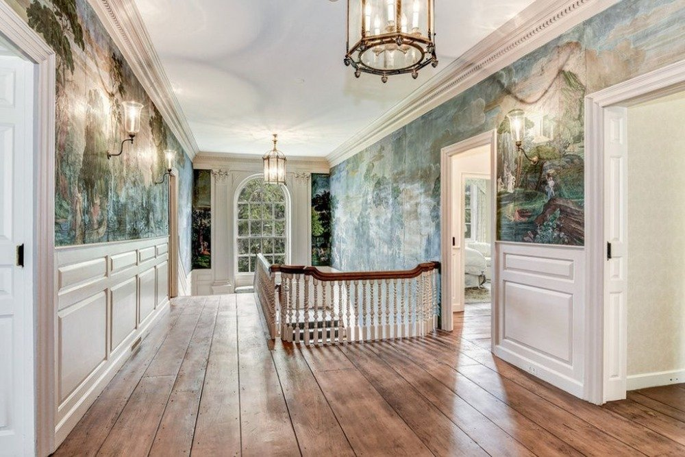 The stunning wall murals extend through the house's second floor landing. Images courtesy of Toptenrealestatedeals.com.