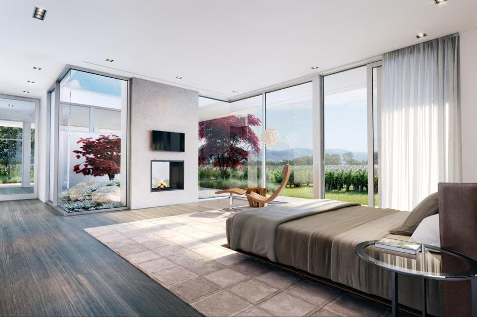 The primary bedroom has a spacious and bright look to it afforded by the tall glass walls flanking the fireplace across from the platform bed. Image courtesy of Toptenrealestatedeals.com.