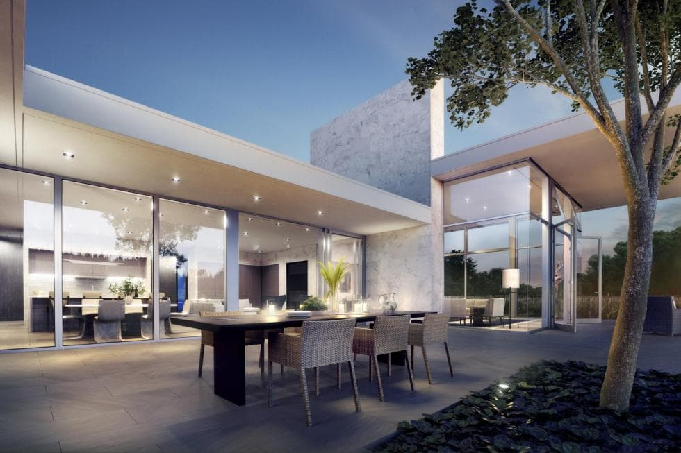 This is the patio just outside the glass walls of the great room. This area is fitted with an outdoor dining area on a wide concrete floor. Image courtesy of Toptenrealestatedeals.com.