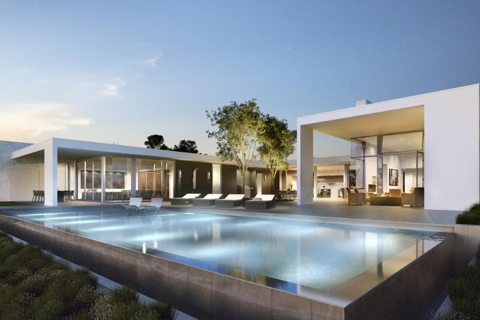 This is the backyard infinity pool with its own lighting. This makes it stand out against the surrounding white exteriors of the house. This view also shows the various outdoor areas of the estate. Image courtesy of Toptenrealestatedeals.com.