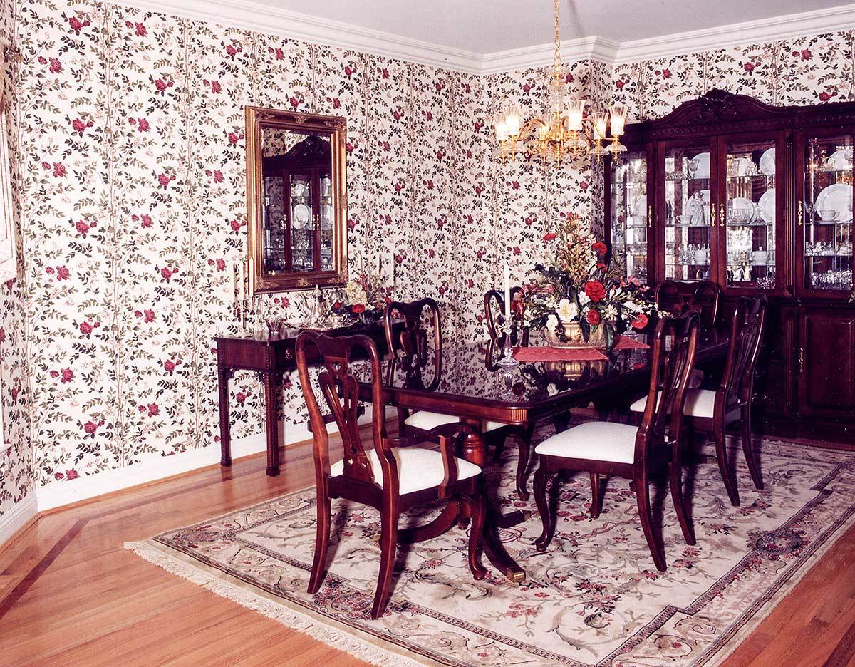 The formal dining room offers a display cabinet, buffet table, and a dark wood dining set illuminated by a gilded chandelier.