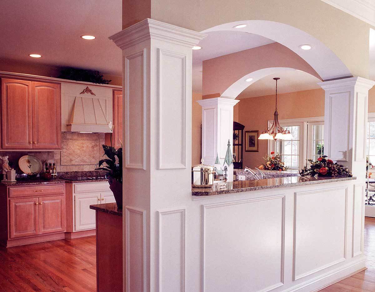 The L-shaped peninsula separates the kitchen from the breakfast nook and living room.