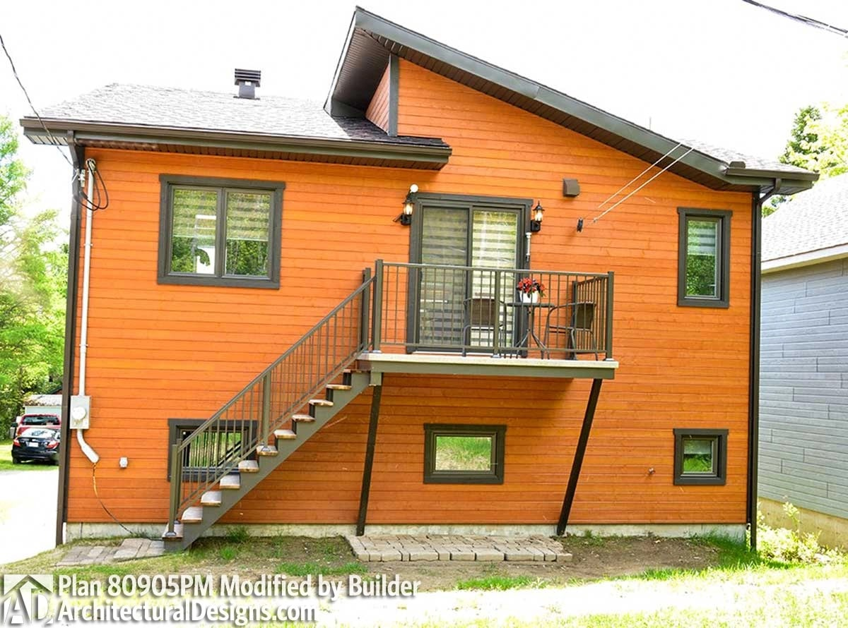 Rear exterior view showing the horizontal siding and a staircase that leads to the main living space.