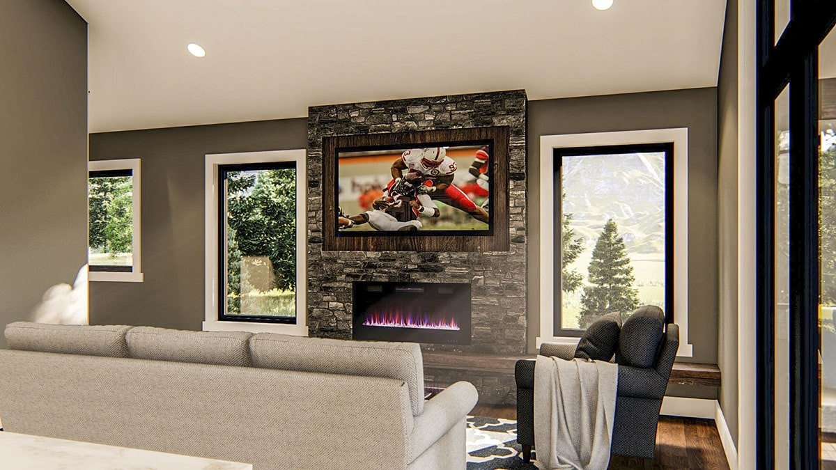 Living room with gray seats, flatscreen TV, and a modern fireplace flanked with picture windows.
