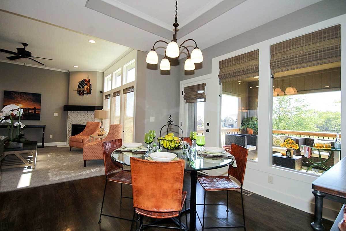 Across the dining area is the family room warmed by a corner fireplace.