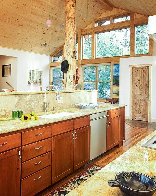 The kitchen offers wooden cabinets, granite countertops, and an undermout sink paired with a gooseneck faucet.