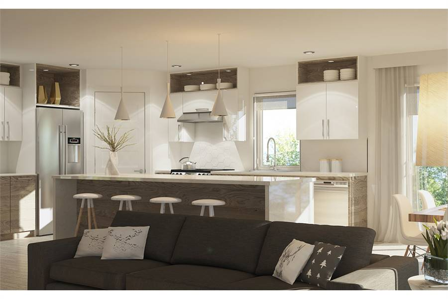 A farther view shows the dining area on the side and the living room in front which features a black sectional sofa.