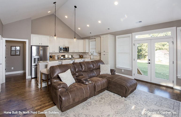 Shared living room and kitchen with cathedral ceiling and a french door on the side that opens out to the backyard.Shared living room and kitchen with cathedral ceiling and a french door on the side that opens out to the backyard.