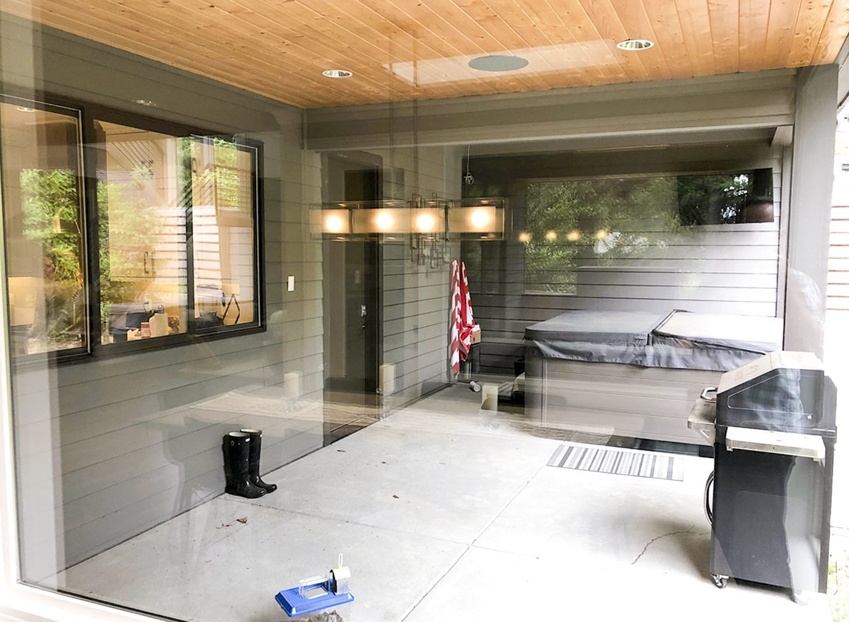 Bbq porch with concrete tiled flooring and wood-paneled ceiling fitted with recessed lights.