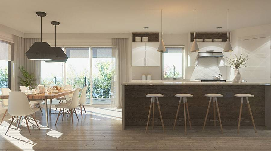 The shared dining and kitchen offer sleek white cabinets, a rectangular dining table, dome pendants, and a marble top peninsula lined with round bar stools.