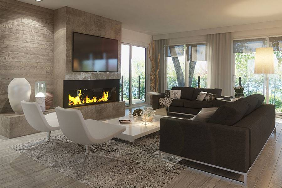Living room with brown couches, white chairs, and a low coffee table facing the modern fireplace and TV.