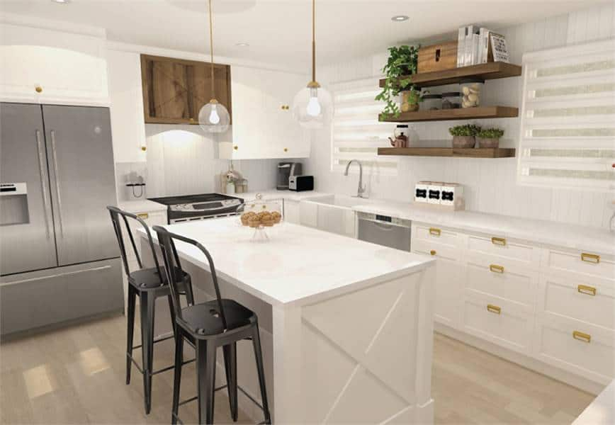 White kitchen with wooden floating shelves, slate appliances, farmhouse sink, marble top island, and custom cabinets accented with brass hardware.
