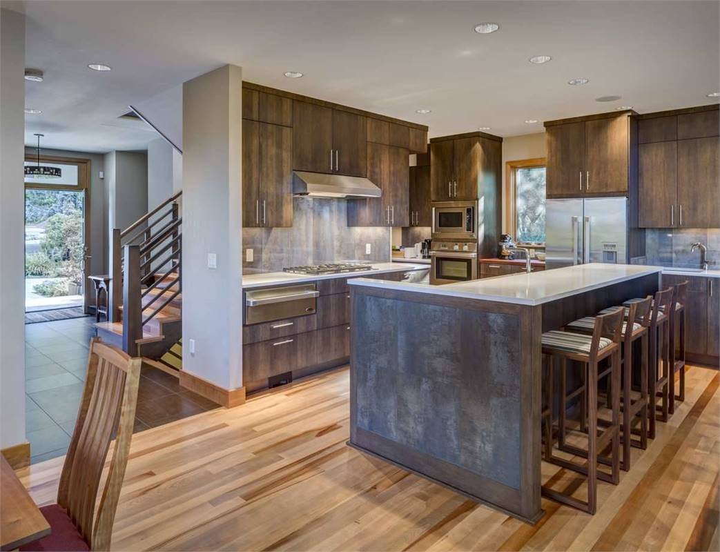 The kitchen seamlessly flows into the dining area and foyer.