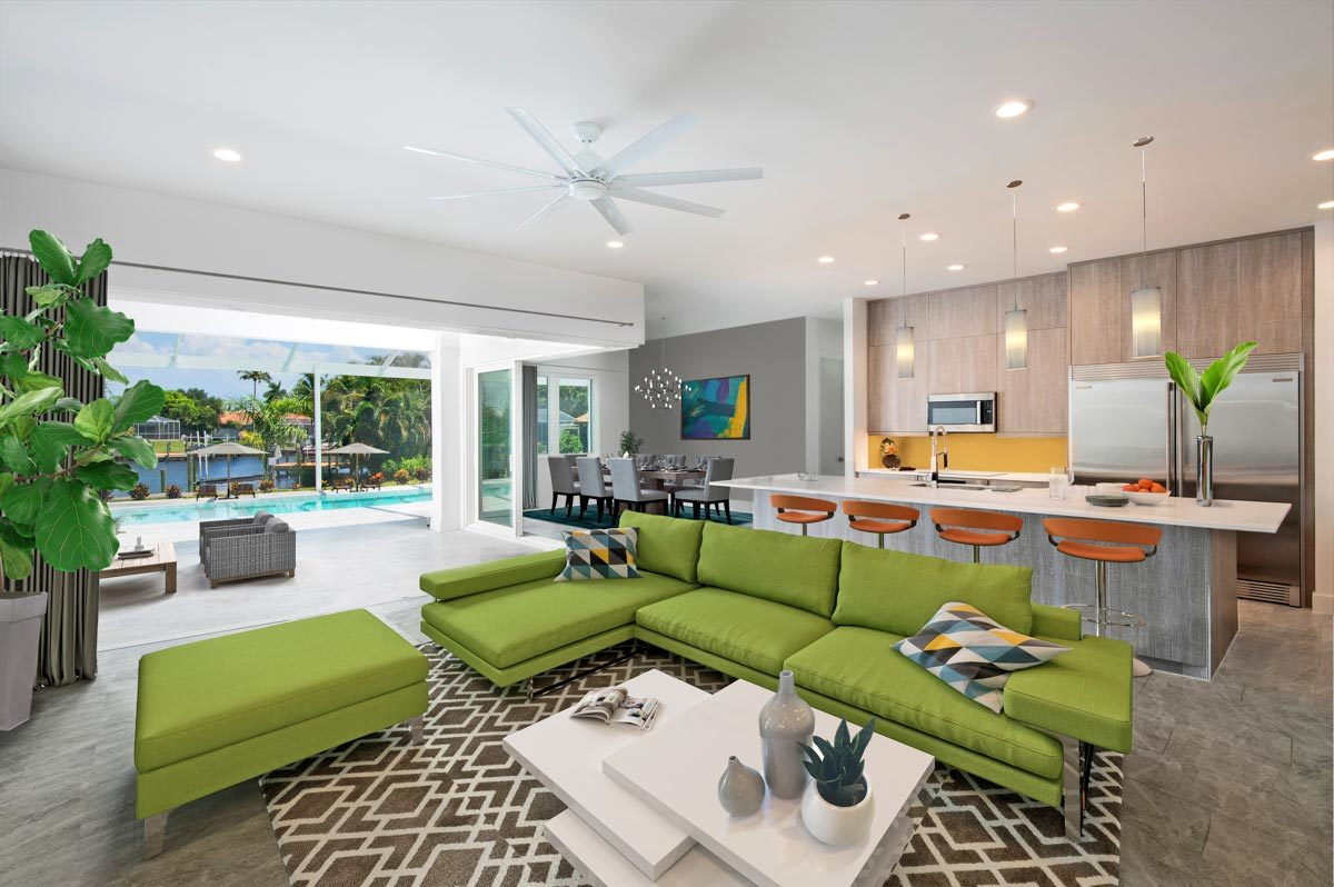 An open layout view showing the living room, kitchen, dining area, and the covered lanai with a swimming pool.