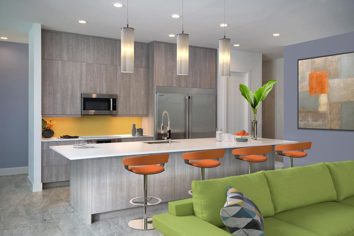The kitchen has sleek wooden cabinetry, stainless steel appliances, and a breakfast island well-lit by cylindrical pendants.