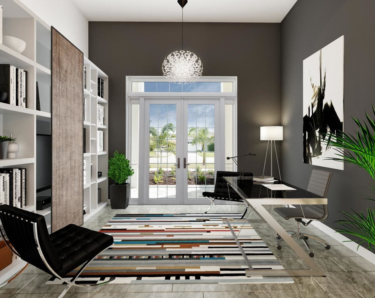 Study with white built-ins, modern furnishings, and a french door that opens out to the front porch.