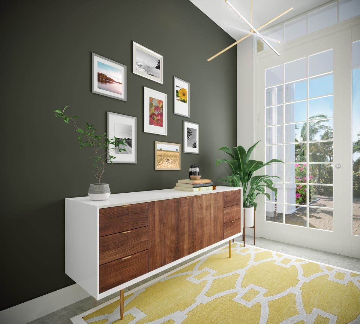 A photo gallery hangs above the wooden console table that sits on a yellow patterned rug.
