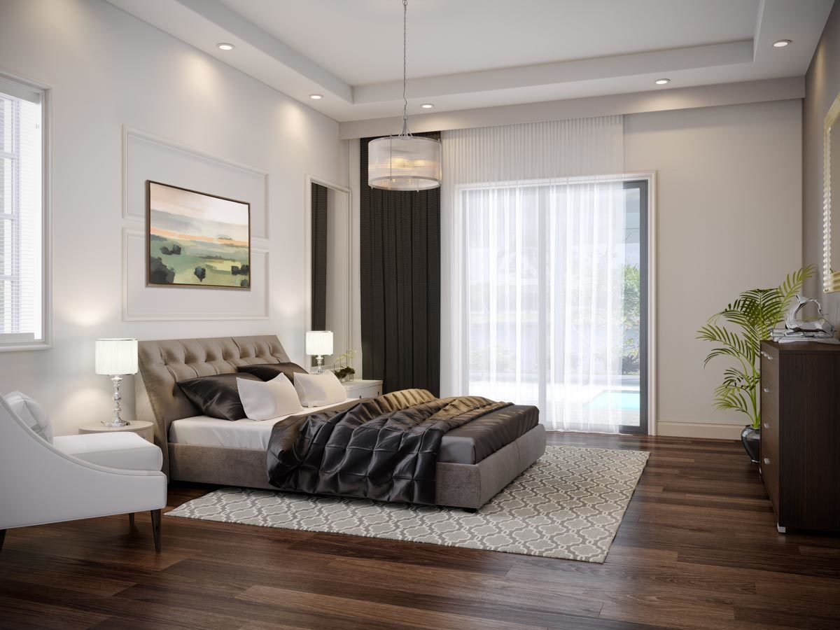 This bedroom features a sleek upholstered bed complemented with a drum chandelier and white cushioned chair.