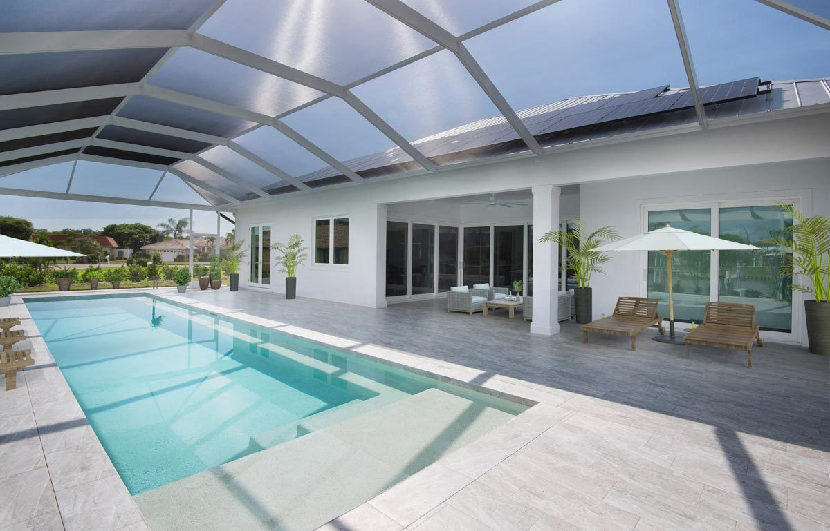 Spacious lanai with multiple seating and a swimming pool topped with a retractable roof.Spacious lanai with multiple seating and a swimming pool topped with a retractable roof.